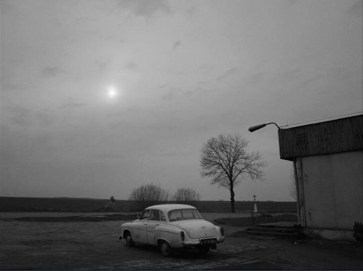 Ida car sun clouds